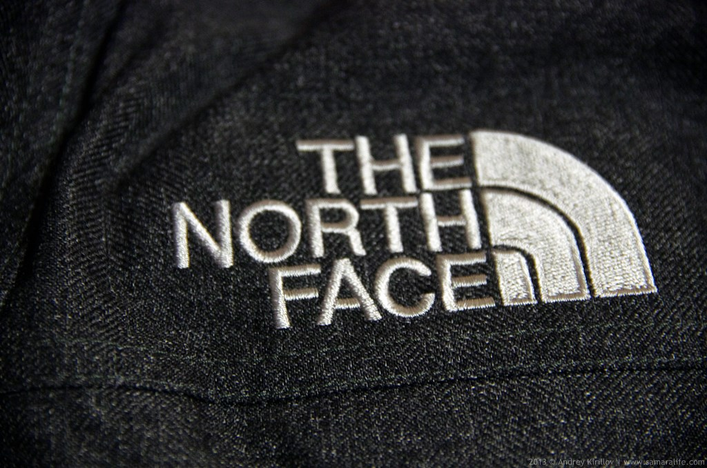 The North Face logo on a parka
